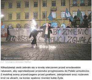 zrzut ekranu z gazeta.pl. Nacjonaliści palą kukłę ŻYda na demonstracji pod wrocławskim ratuszem