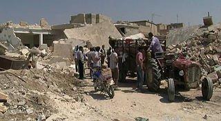 Zrujnowane Azaz. W okolicy tego miasta koczuje 30 tys. uchodźców, mających nadzieję na otwarcie tureckiej granicy / fot. Wikimedia Commons