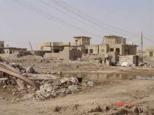 Zrujnowane domy w Faludży/wikimedia commons